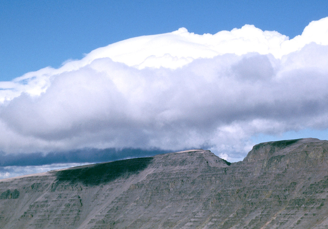 Picture of clouds condensing as the air is pushed up a mountain side, Kiger Notch, Steen's Mountain, Washington state, USA.