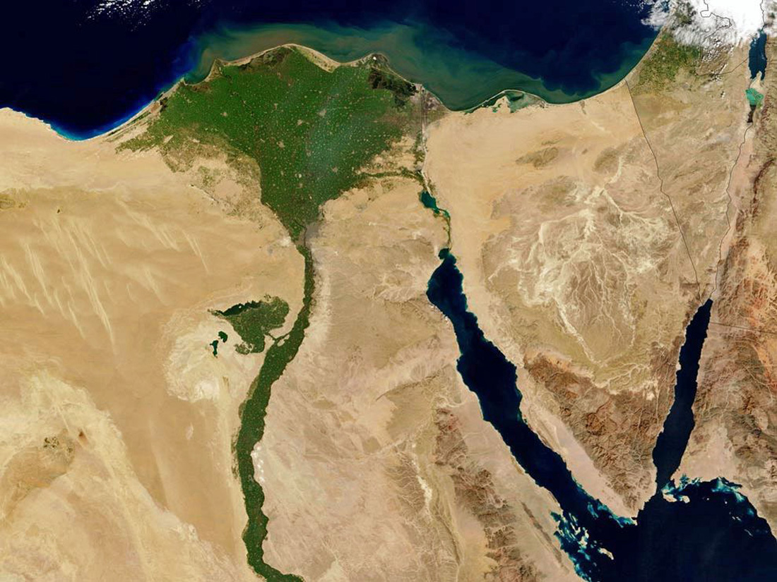 Satellite view by NASA showing the Nile Valley in Egypt, and how there is lush growth along the Nile River and in the Nile delta.