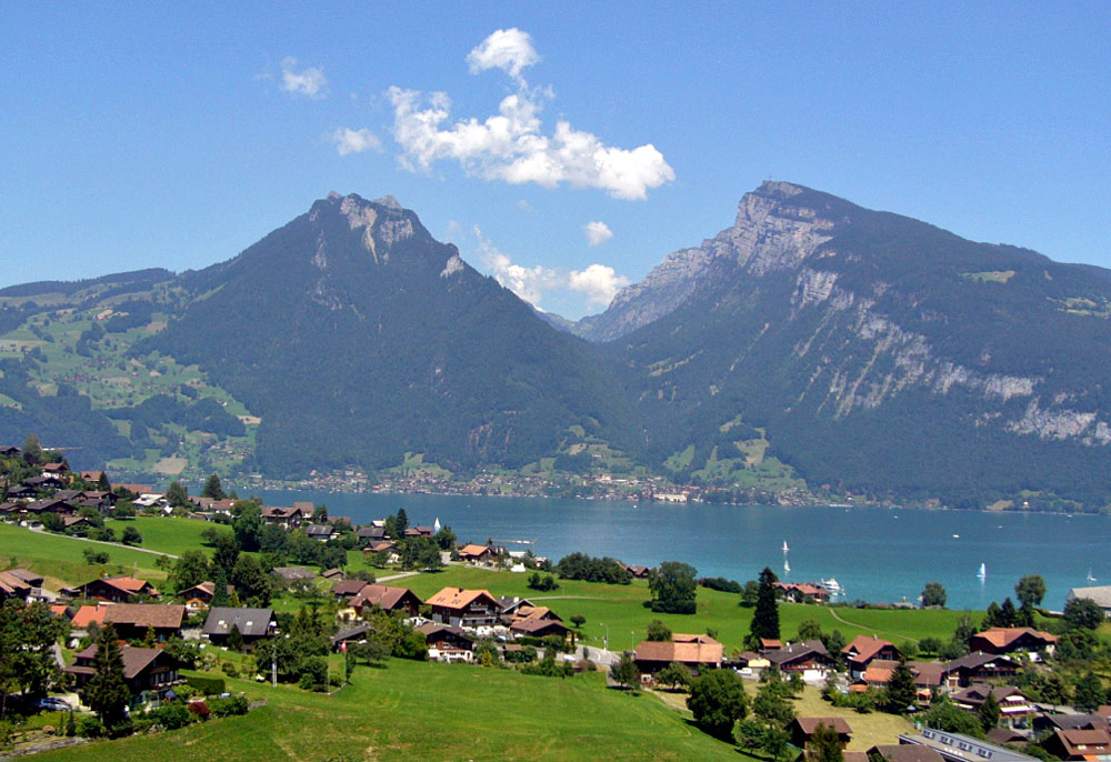 A lake near Interlaken, Switzerland serves many purpose, both natural and for humans.