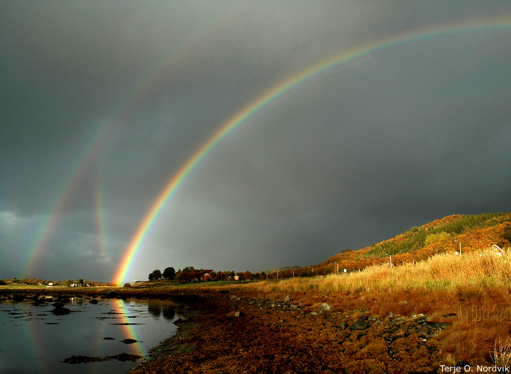 Mulitiple rainbows seen in a passing rainstorm in Norway. Credit: Terje O. Nordvik)