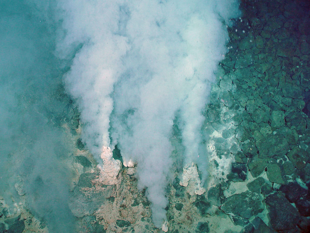 The Mariana Arc is part of the Ring of Fire in the western Pacific Ocean where tectonic plates are moving relatively quickly. Hydrothermal vents, such as these, are present, and they release large amounts of carbon dioxide and minerals.